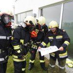 Einweisung des Atemschutztrupps mit Brandschutzplan